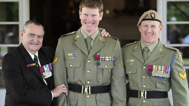Heroes all ... Corporal Daniel Keighran VC is congratulated by WO2 (retired) Keith Payne VC, left, and SAS Corporal Mark ...
