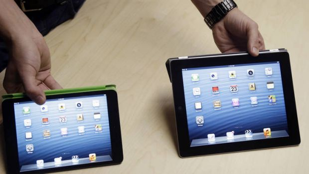 Compare the difference: the iPad mini, left, and the iPad4.