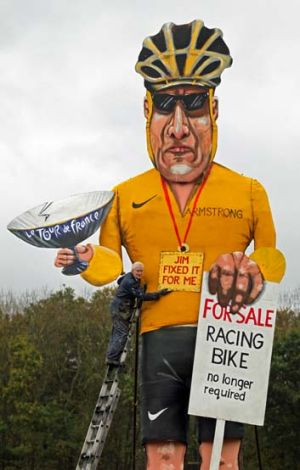 Artist Frank Shepherd with his creation ... US cyclist Lance Armstrong has been unveiled as this year's Edenbridge ...