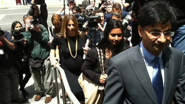 Lloyd Rayney, his daughter Sarah and legal team enter court on the day of the verdict.