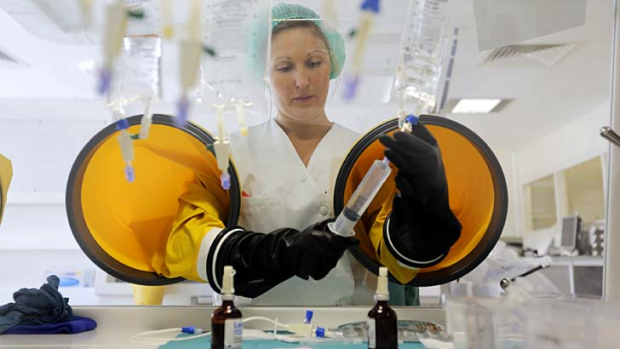 A dispensing chemist prepares drugs for a chemotherapy treatment in a sterile room at Antoine-Lacassagne Cancer Centre ...