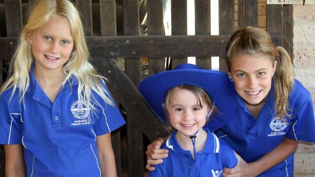 Adam Road Primary School students Sophie, Estella and Amber - the latter of whom received detention for hugging a friend ...