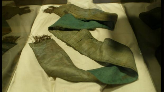 Green sash at Benalla Costume Museum presented to Ned Kelly by the Sheltons and worn under his armour at Glenrowan ...