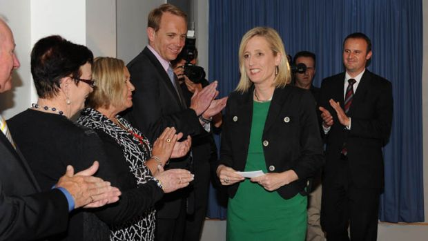Gallagher  is applauded by Simon Corbell, Andrew Barr and other Labor MLAs after her press conference.