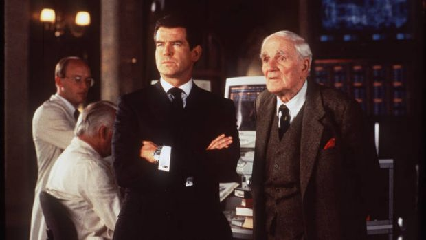 Pierce Brosnan as Bond and Desmond Llewellyn as Q in <i>The World Is Not Enough</i>.