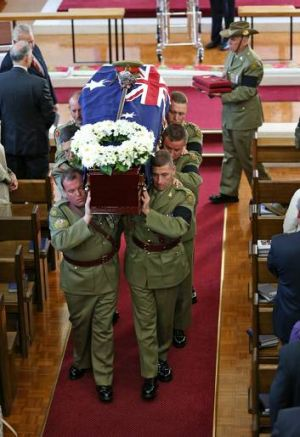 Major General Alan Stretton's pallbearers carry the casket from the Royal Military College Chapel in Canberra.