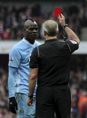 A good referee's similar to a good office manager. But you might not convince Mario Balotelli.