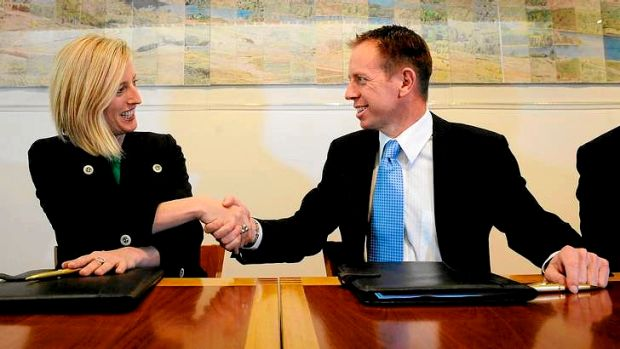 ACT Chief Minister Katy Gallagher and Greens MLA Shane Rattenbury are all smiles after signing the agreement.