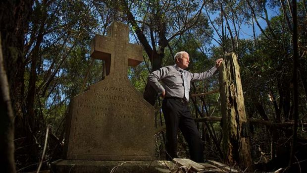 March of time … the Wollongong mayor, Gordon Bradbery, at the neglected and overgrown Waterfall Cemetery, where ...