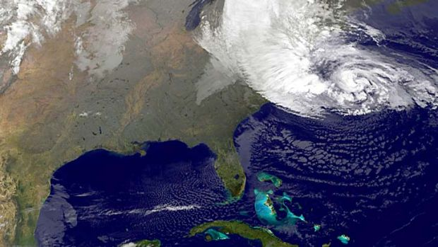 Hitting home ... a satellite image of Sandy on the east coast of the US.