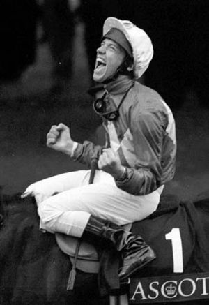 Dettori celebrates after riding all seven winners at Ascot in 1996.