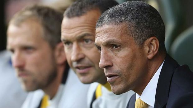 Get tough … Norwich manager Chris Hughton, right, says racism should attract a 10-game ban.
