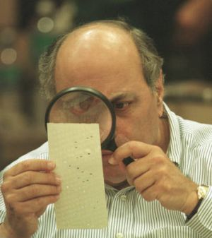 The infamous recount: A judge uses a magnifying glass to view a dimpled chad on a ballot in 2000 in Florida.