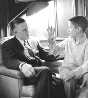 Political family ... young Mitt Romney with his father, George.