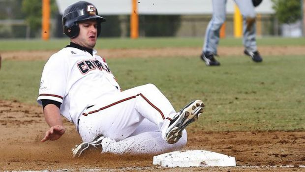 Canberra Cavalry's Jeremy Barnes slides into third.