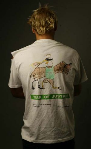 "The ""Year of Justice"" T-shirt worn by St John's students shows an eagle (the college symbol), which is blindfolded and ..."