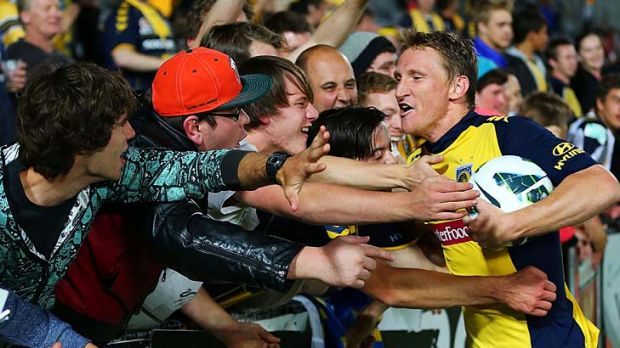 Give me a hand: Central Coast's Daniel McBreen shares his hat-trick with the fans on Saturday night.