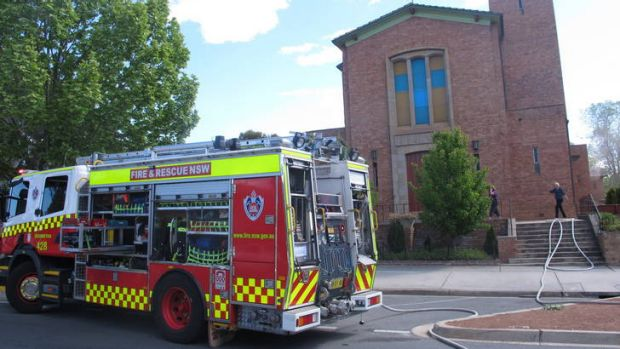 Firefighters fight a blaze that threatened to completely destroy St Raphael's Church on Lowe Street in Queanbeyan on Friday.