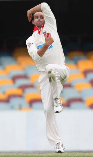 Slow start: Nathan Lyon in full flight.