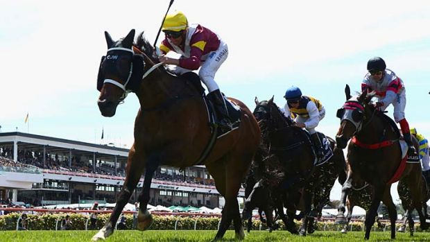 Lively and hopeful: Nash Rawiller riding Kelinni crosses the line to win the Lexus Stakes.