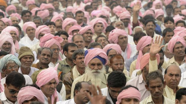 Promises ... supporters of the Congress listen to speeches during a party rally in Delhi on Sunday.