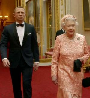 Politically correct colours ... Queen Elizabeth II, with Daniel Craig, in her Olympic outfit.