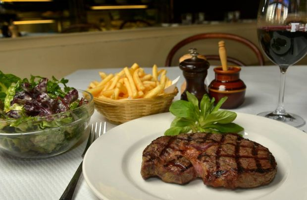 8. Steak, frites and a glass of anything red served at France Soir.