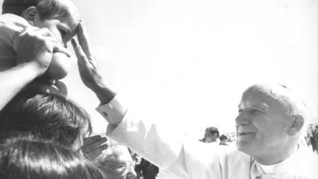 The visit of Pope John Paul II at the RAAF Base Fairbairn in 1986 ... Pope John Paul II blesses a young boy as he meets ...