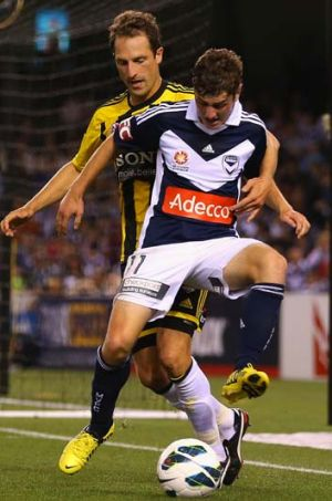 Old friends ... Marco Rojas of the Victory and Andrew Durante of the Phoenix fight for the ball.