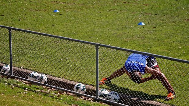 Facing the music ... Sydney FC player Fabio Alves stretches at a Sydney FC recovery session.