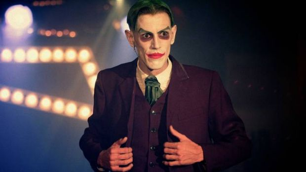 The Joker, played by Anthony Howes, is among a rogues' gallery of vaudevillian villains.