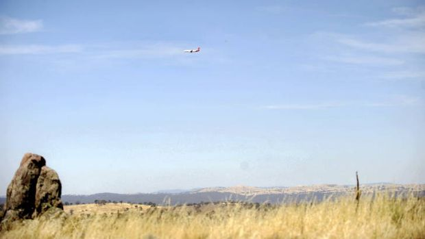 A plane heads towards the Canberra airport near Tralee.