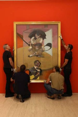 Orange background proved a winner ... main image of Seated figure being hung in the Art Gallery of NSW.