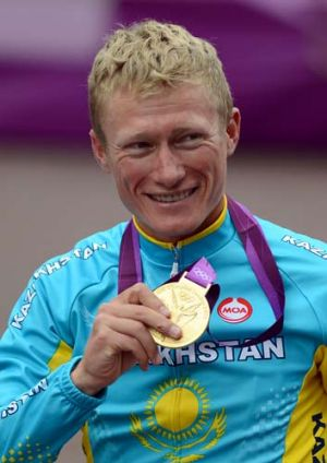 Alexandre Vinokourov holds his gold medal after he won the men's road race at the Olympic Games in London on July 28.