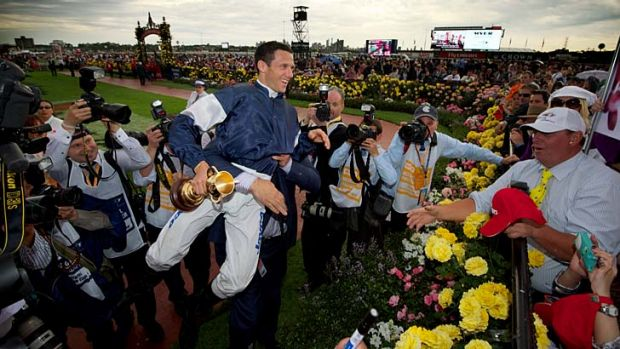 Allow me...Nick Williams gives Brett Prebble a leg-up after the Cup.