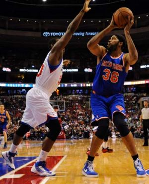 Rasheed Wallace of the Knicks shoots over Lavoy Allen of the Sixers.