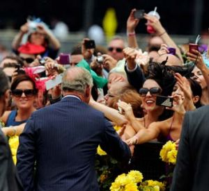 Crowd favourite ... Prince Charles greets racegoers upon his arrival at Flemington. He later presented the Diamond ...