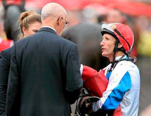 Americain's jockey Damien Oliver talks to trainer Alain De Royer Dupre after the Melbourne Cup.