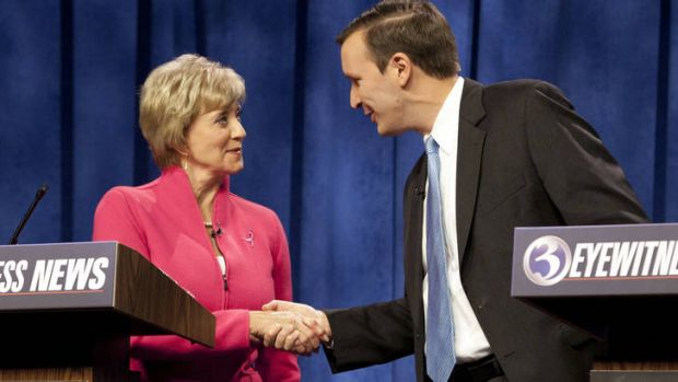Republican loser ... Linda McMahon, left, shakes hands with her Democratic opponent, Chris Murphy, in the Connecticut ...