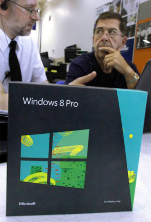 A consultant explains Windows 8 to a potential customer.