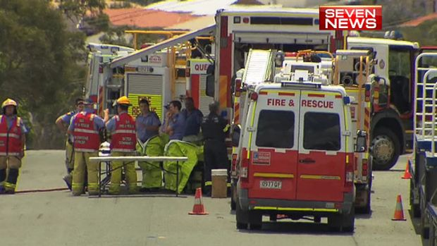 Emergency crews at the scene of a chemical spill at Heathwood, near the Logan Motorway.
