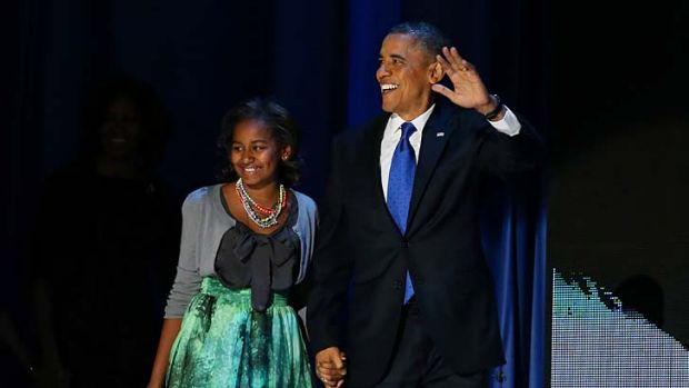 Winner ... US President Barack Obama walks on stage with daughter Sasha to deliver his victory speech.
