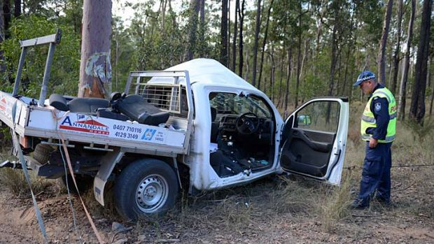 Forensic Crash investigator Sergeant Steve Webb inspects the wreck of the Nissan Navara ute. Photo: <B><A href= ...