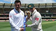 Graeme Smith and Michael Clarke pose with the trophy before their team's clash in the first cricket test at the Gabba ...