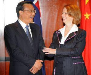 Li Keqiang is expected to be China's next premier. He is pictured with Australian Prime Minister Julia Gillard in ...
