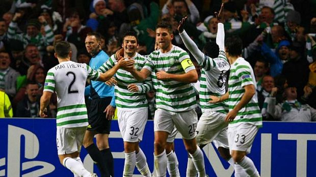 Ecstasy ... Celtic player's celebrate Tony Watt's goal which put them 2-0 up against Barcelona.