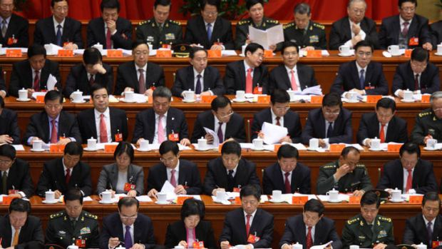 Delegates attend the opening of the 18th National Congress of the Communist Party of China at the Great Hall of the ...