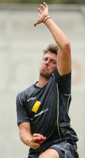 James Pattinson bends his back in the nets at the Gabba.