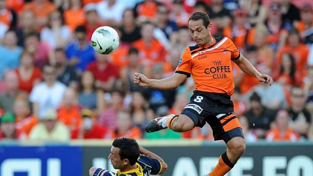 Once a Roar recruit: Massimo Murdocca (right) challenges Central Coast's John Hutchinson.