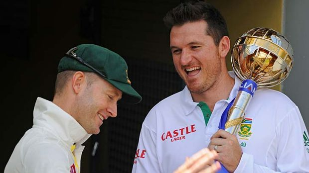 Graeme Smith and Michael Clarke share a laugh yesterday.